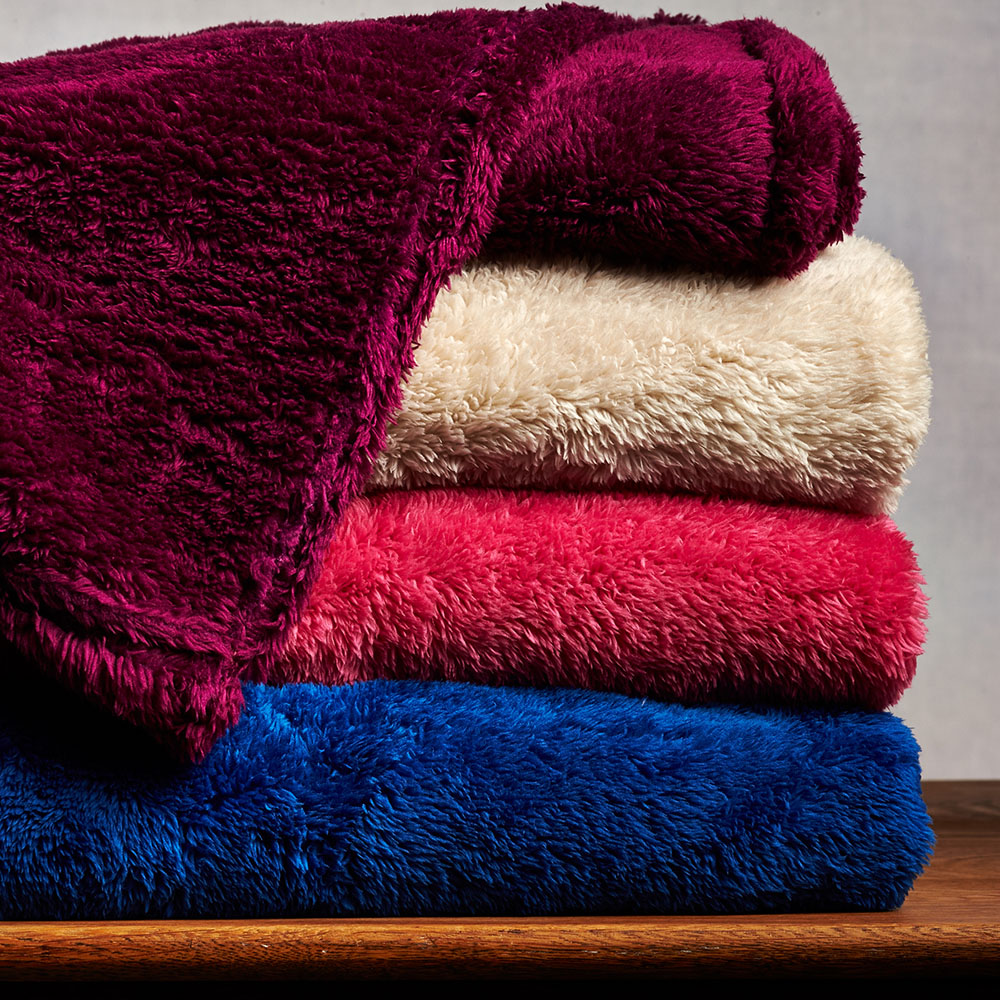 Fluffy throw blankets manufactured by birmi
