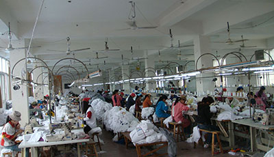 Workers doing work in Birmi Manufacturing Unit of Panipat